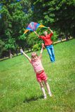 The girl and her father play with a kite. Royalty Free Stock Photos