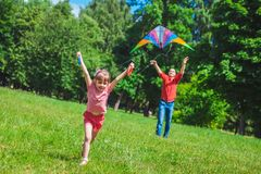 The girl and her father play with a kite. Stock Image