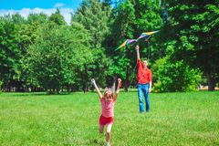 The girl and her father play with a kite. Stock Photo