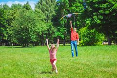 The girl and her father play with a kite. Stock Photography