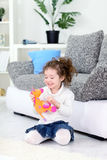 Girl and her favorite soft toy. Cute girl playing with her favorite soft toy Stock Photo