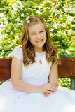 Girl in her First Communion Day Stock Photo