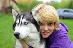 Girl and her friend, siberian husky. People and nature Stock Photography