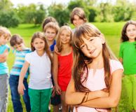 Girl with her friends in the park Royalty Free Stock Photography