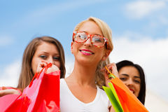 Girl With Her Friends After Shopping Royalty Free Stock Photos