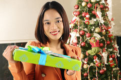 Girl and her gift. Picture of a happy girl after receiving a gift Royalty Free Stock Photography