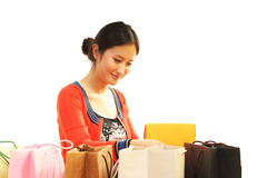 Girl and her gifts. Received a gift girl, happy smile royalty free stock images
