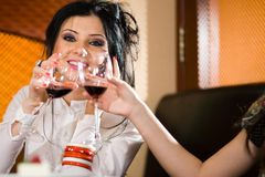 Girl with her girlfriend with wineglasses Stock Photo