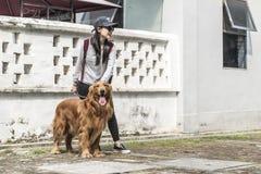 Girl and her golden retriever Stock Photo