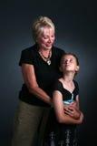 Girl and her grandmother Stock Image
