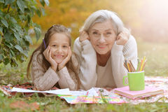 Girl with her grandmother drawing Stock Photography