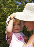 Girl and her grandmother in a hat stock photos