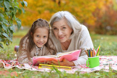 Girl with her grandmother reading Royalty Free Stock Image