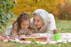 Girl with her grandmother reading Royalty Free Stock Images