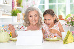 Girl with her grandmother using  tablet Royalty Free Stock Photo