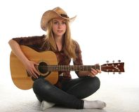 Girl and her guitar Stock Images