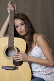 A girl and her guitar Royalty Free Stock Image