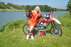 Girl with her hair around a motocross bike stock photography