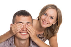 Girl with her hands covering his eyes guy Stock Photography