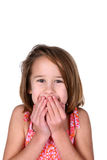 Girl with her hands over her mouth Royalty Free Stock Images