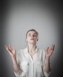 Girl with her hands up. Slim woman with her hands up. Concentration concept Stock Photo