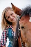 Girl and her handsome horse Stock Image