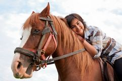 Girl and her handsome horse. Beautiful girl and her handsome horse Stock Photo