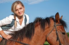 Girl and her handsome horse Royalty Free Stock Photography