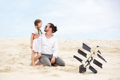 Girl with her happy father flying kite coast ocean Royalty Free Stock Images
