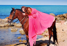 Girl with her horse. A portrait of a caucasian girl with her horse Stock Photography