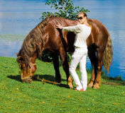 Girl and her horse Stock Images