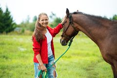 Girl with her horse Royalty Free Stock Images