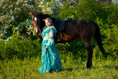 Girl and her horse. Royalty Free Stock Image