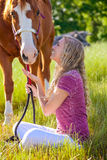 A girl and her horse sitting Royalty Free Stock Image