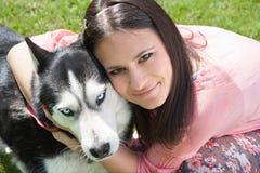 Girl and her husky Stock Photos