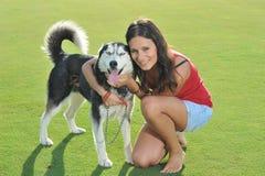 Girl and her husky Stock Photo