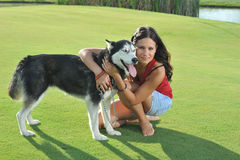 Girl and her husky Royalty Free Stock Images