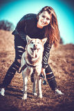 Girl and her husky dog outdoor in the forest Royalty Free Stock Images