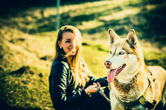Girl and her husky dog outdoor in the forest Stock Photography
