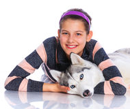 Girl with her Husky Stock Images