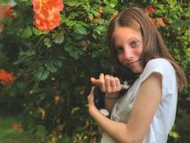 Girl and her kitty in hand stock image