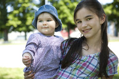 Girl with her little sister Stock Images