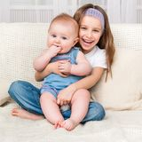 Girl and her little sister Stock Photography