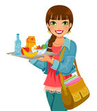 Girl with her lunch. Girl holding a tray with lunch Royalty Free Stock Photo