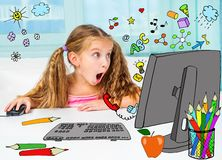 Girl and her magic computer Stock Photos