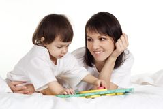 Girl with her mama Stock Photography