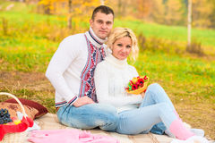 Girl and her man on a picnic Stock Images