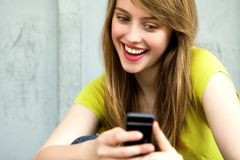 Girl with her mobile phone Royalty Free Stock Photography