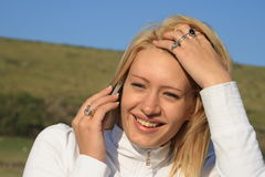 Girl on her mobile phone. Stock Photography