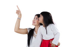 Girl and her mom looking at copyspace Royalty Free Stock Photography